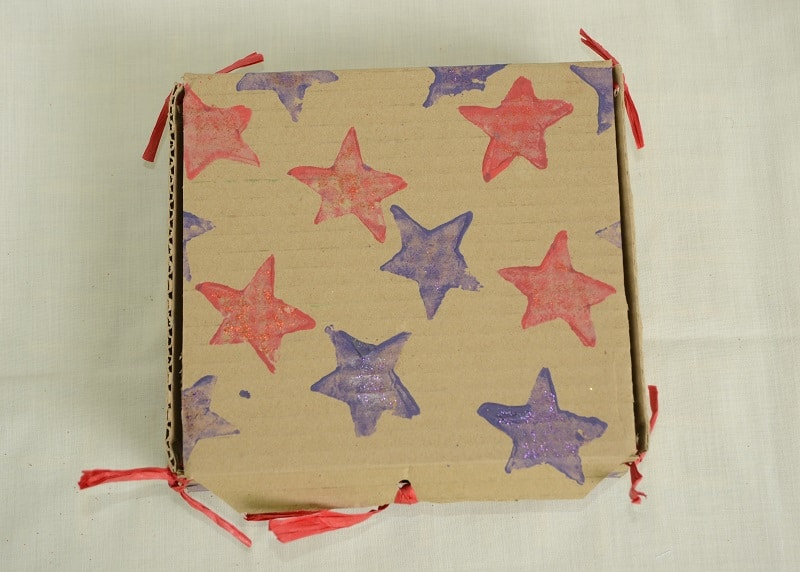 Gift box decorated with potato stamps