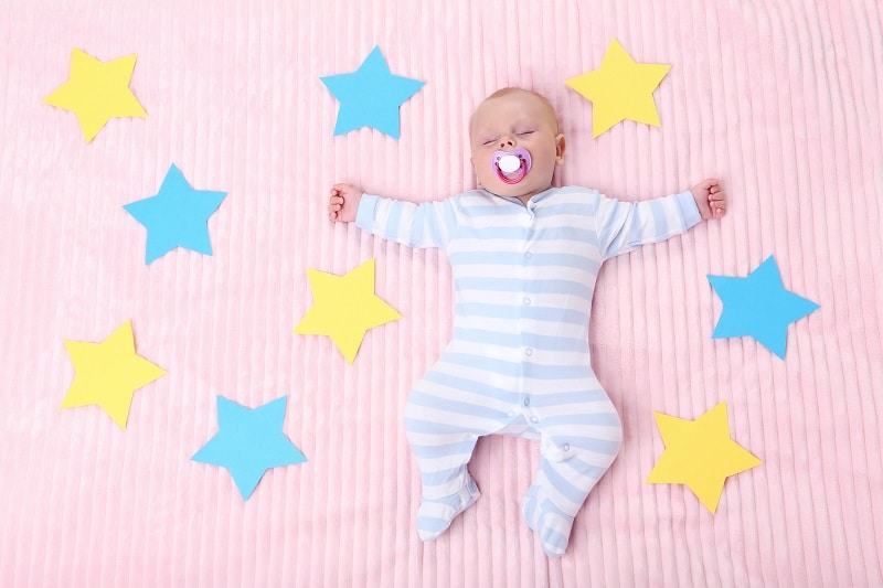 when do babies sleep through night