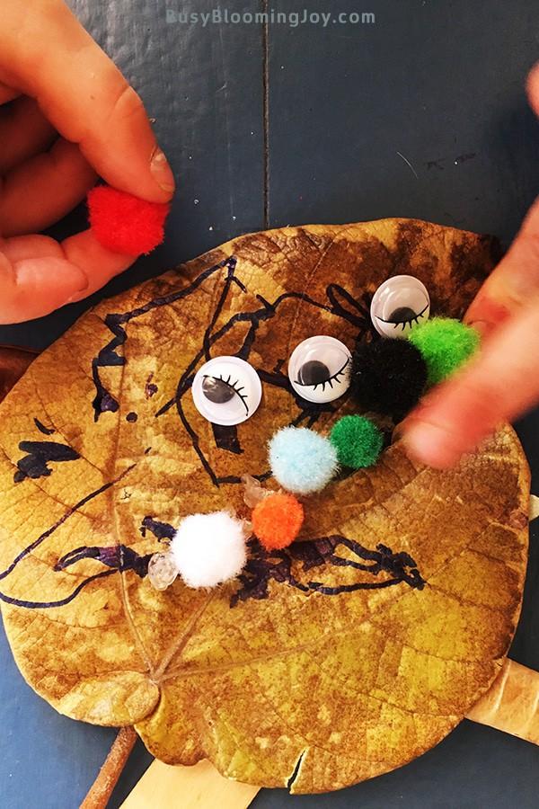 Sticking pompoms onto lead monster craft
