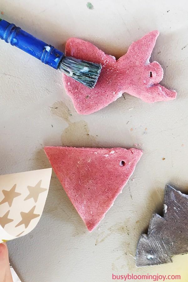 Modge podging the salt dough tree ornaments