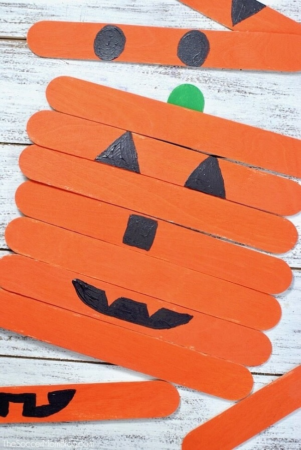 Pumpkin faces with craft sticks for toddlers