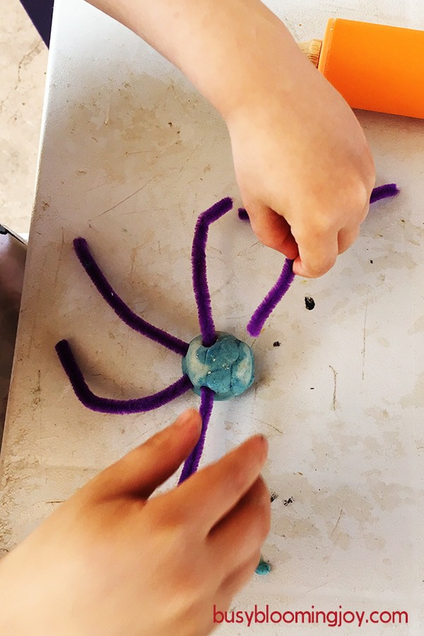 making playdough pipe cleaner spider