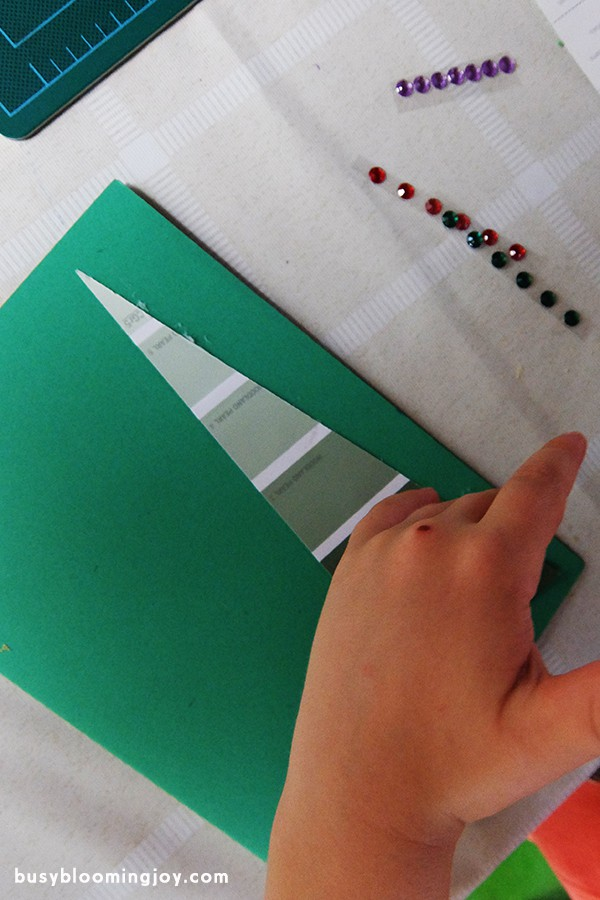 Sticking paint chip onto Christmas tree card