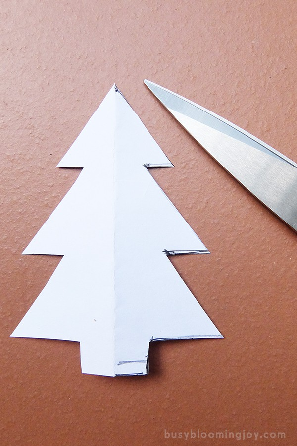 cut out christmas tree outline to make a template