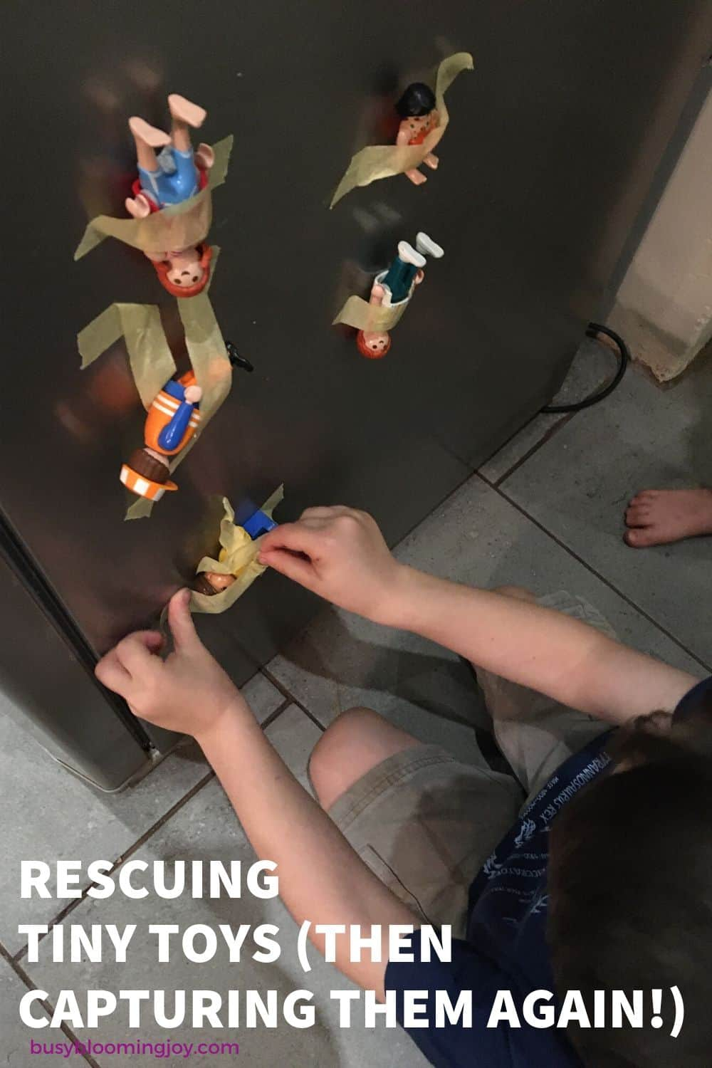 rescuing taped toys - super easy at home toddler activity