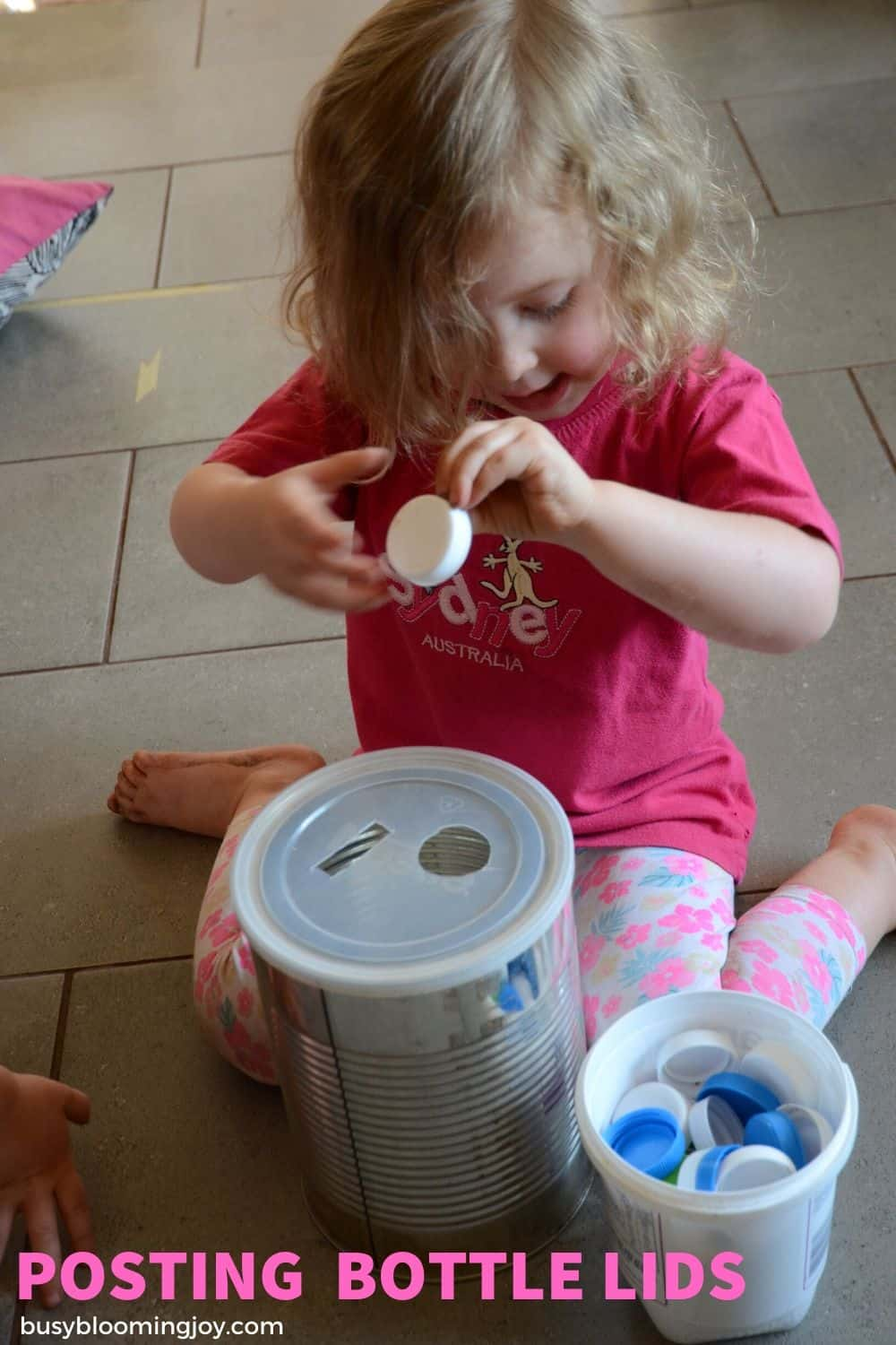 Bottle tops and a small hole easy toddler activity to do at home