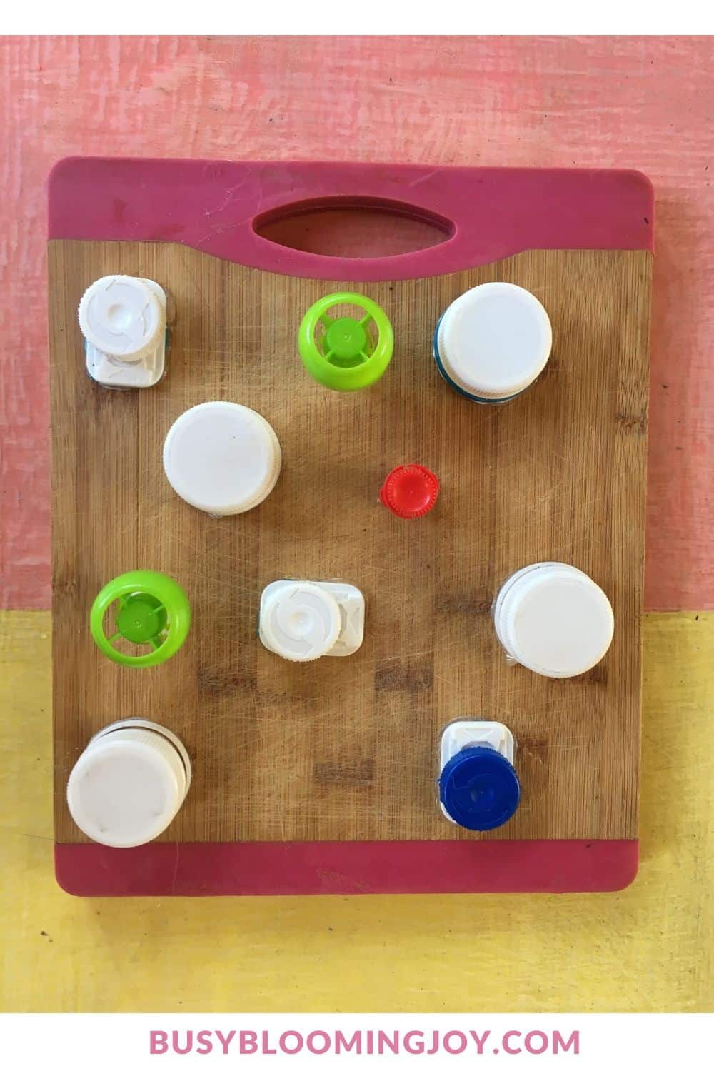 DIY fine motor toy with lids on