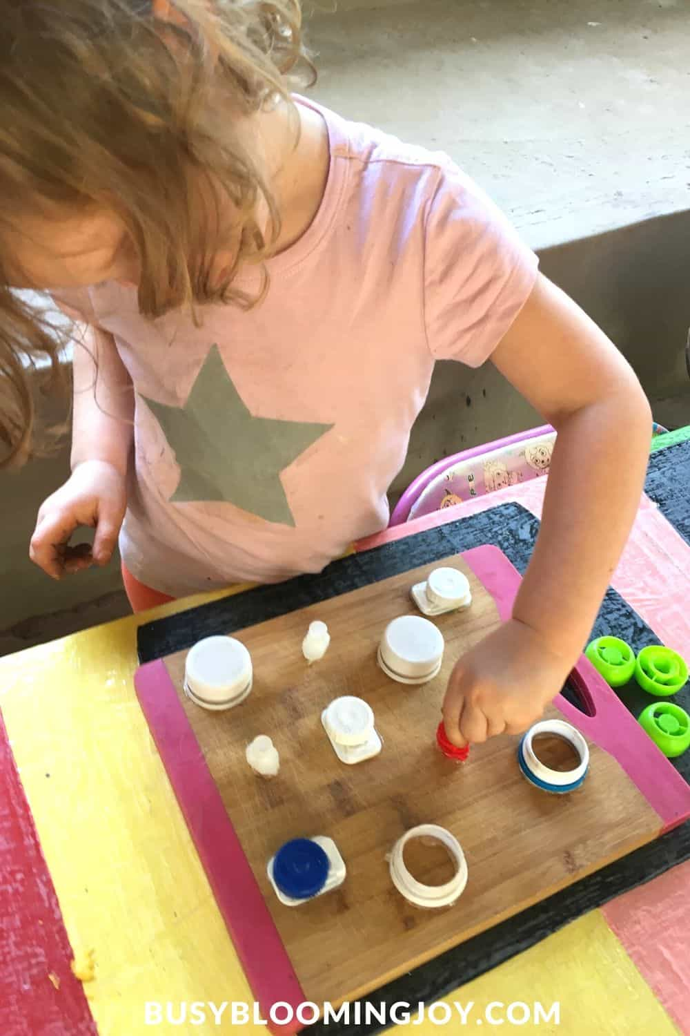 DIY fine motor toy being played with my toddler