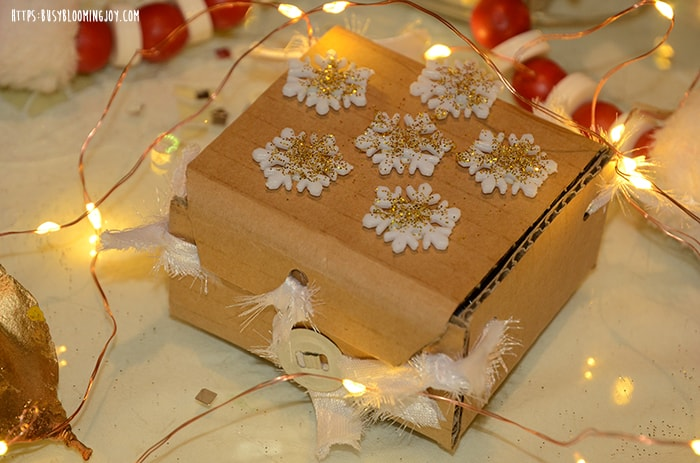 Homemade box decorating for toddlers at Christmas