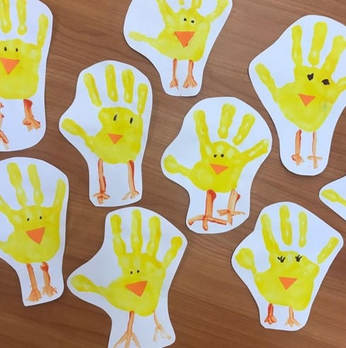 Handprint Easter chicks from @spanishclass4peques