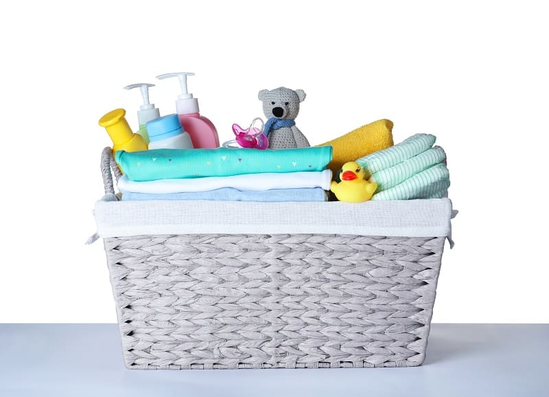 Gather supplies and baby bath products before starting to bathe your newborn