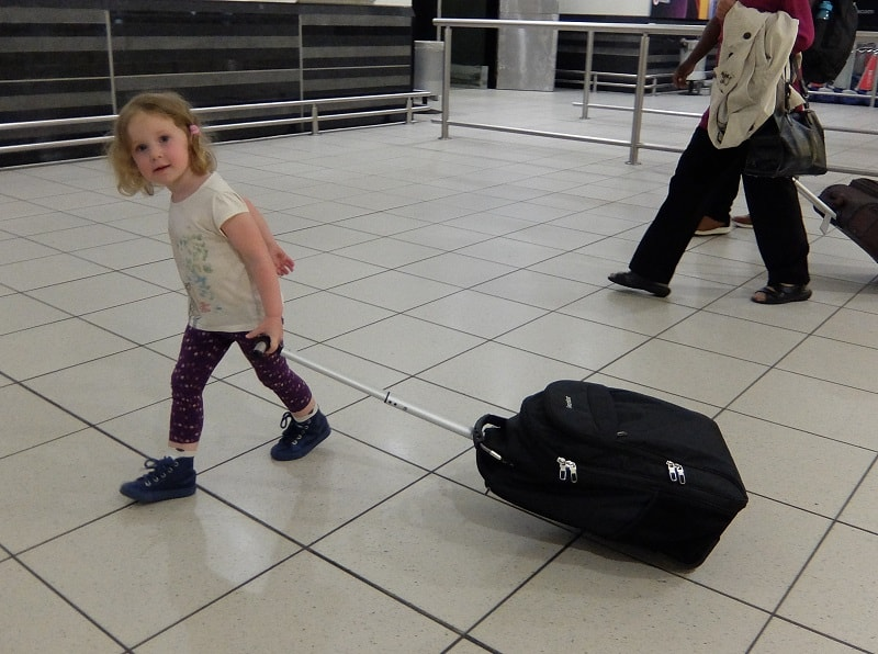 traveling with a newborn - use a backpack or wheelie bag