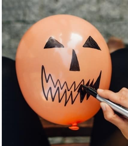Halloween party ideas for toddlers - balloon filled candy to pop
